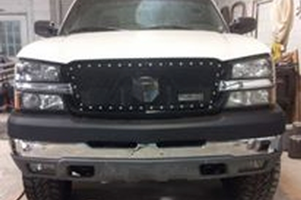 front of white chevy truck
